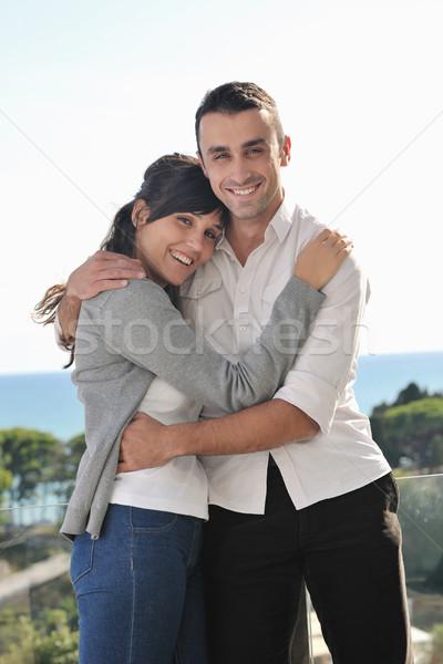 couple relaxing on balcony Stock photo © dotshock