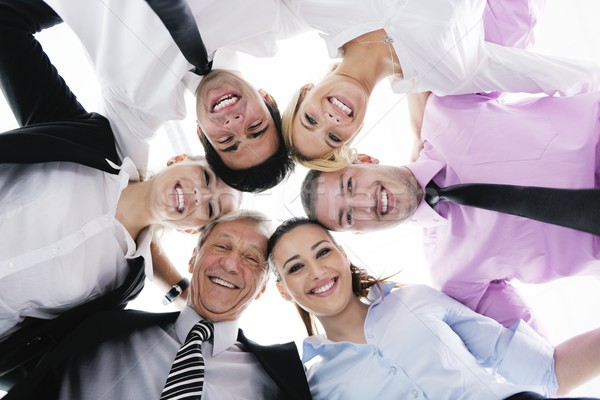 business people with their heads together Stock photo © dotshock