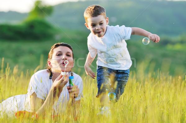 Nő gyermek buborék boldog szabadtér játszik Stock fotó © dotshock