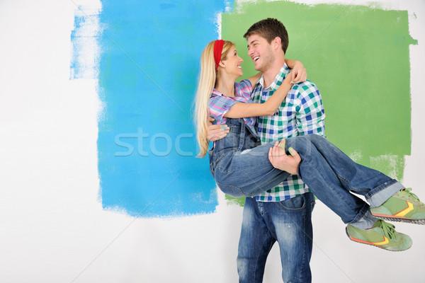 Mutlu çift boya duvar yeni ev Stok fotoğraf © dotshock