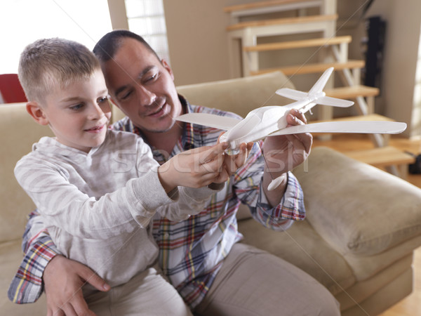 father and son assembling airplane toy Stock photo © dotshock