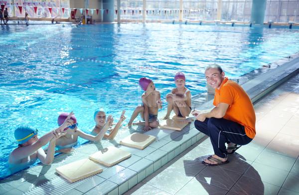 Boldog gyerekek csoport úszómedence gyerekek osztály Stock fotó © dotshock