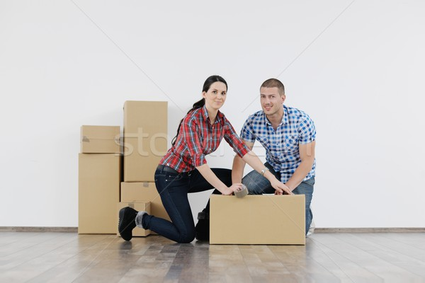 Young couple moving in new house Stock photo © dotshock