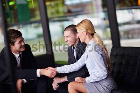 Pessoas de negócios tratar aperto de mãos assinar Foto stock © dotshock