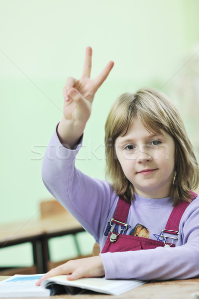 happy child  in schoold have fun and learning leassos Stock photo © dotshock