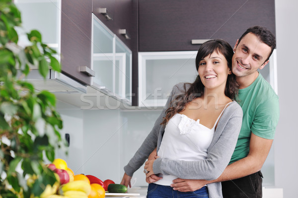 Young love couple taking fresh morning cup of coffee   Stock photo © dotshock