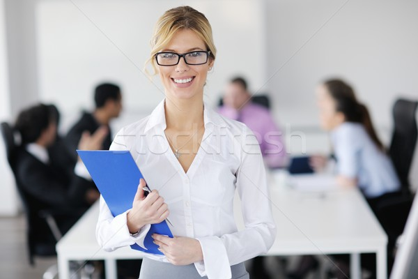 business woman standing with her staff in background Stock photo © dotshock