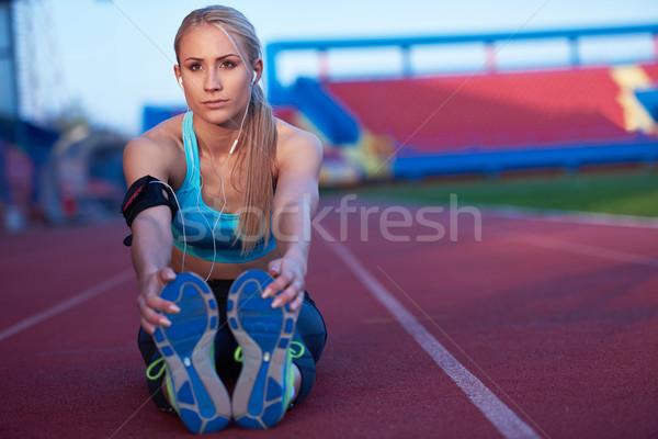 Kadın yarış pisti genç koşucu Stok fotoğraf © dotshock