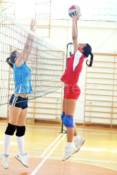 girls playing volleyball indoor game Stock photo © dotshock