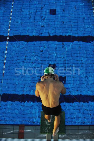 Genç yüzme başlatmak pozisyon yarış uygun Stok fotoğraf © dotshock