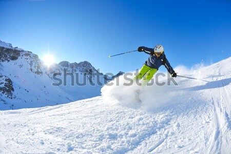 skiing on fresh snow at winter season at beautiful sunny day Stock photo © dotshock