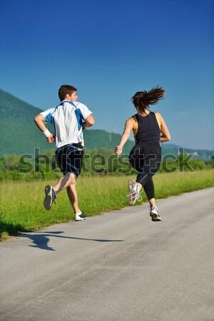 Young couple jogging Stock fotó © dotshock