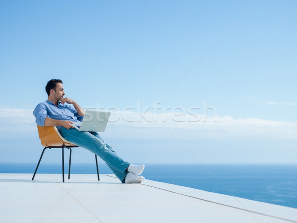 молодым человеком домой балкона красивый расслабляющая Сток-фото © dotshock