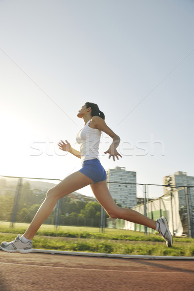 woman jogging at early morning Stock photo © dotshock