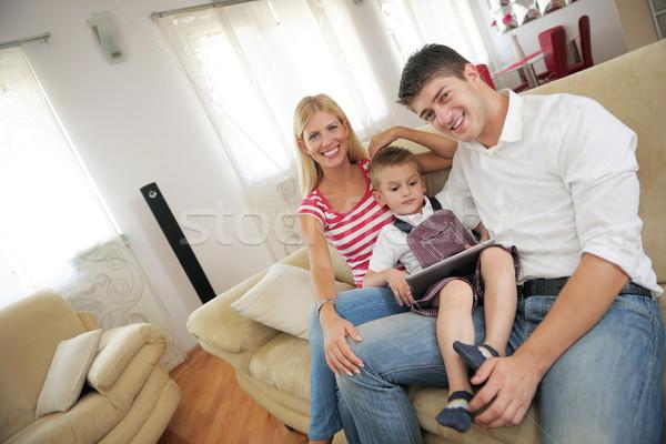 Családi otthon táblagép boldog fiatal család modern Stock fotó © dotshock