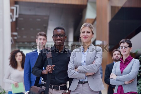 business woman standing with her staff at conference Stock photo © dotshock