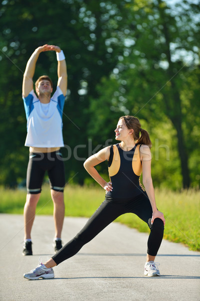 people doing stretching exercise  after jogging Stock photo © dotshock
