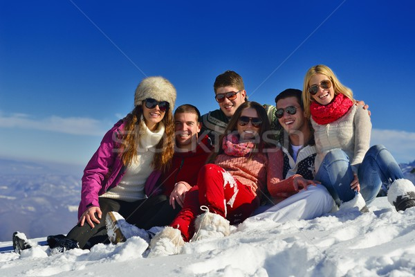 friends have fun at winter on fresh snow Stock photo © dotshock