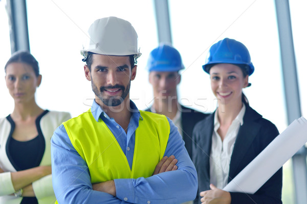 business people and construction engineers on meeting Stock photo © dotshock