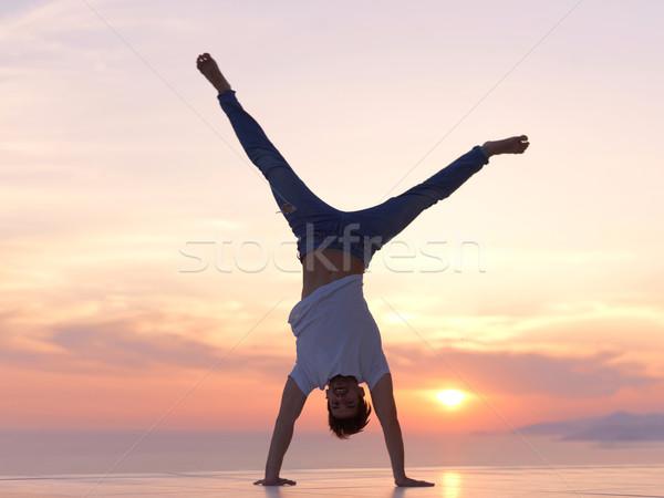 Nyugodt fiatalember otthon erkély jóképű megnyugtató Stock fotó © dotshock