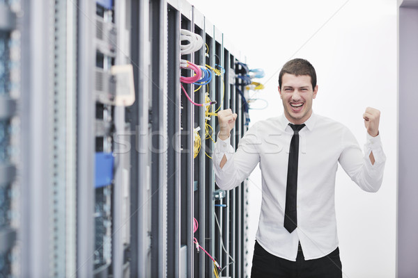 young engeneer in datacenter server room Stock photo © dotshock