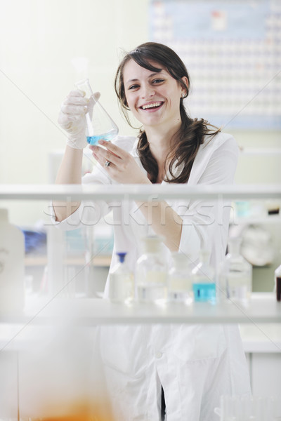 Stock photo: young woman in lab