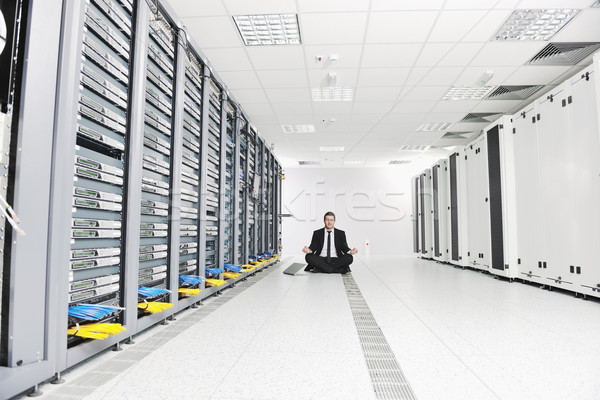 business man practice yoga at network server room Stock photo © dotshock