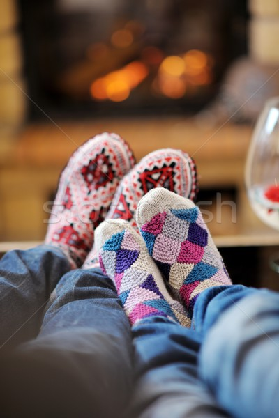 Young romantic couple relax on sofa in front of fireplace at hom Stock photo © dotshock