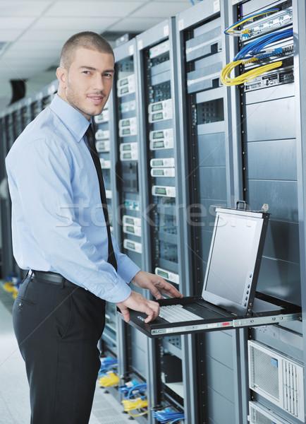 young it engeneer in datacenter server room Stock photo © dotshock