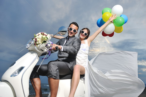 just married couple on the beach ride white scooter Stock photo © dotshock