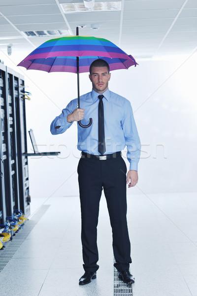 Imprenditore tenere ombrello server stanza giovani Foto d'archivio © dotshock