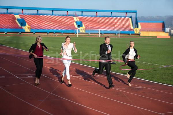 business people running on racing track Stock photo © dotshock