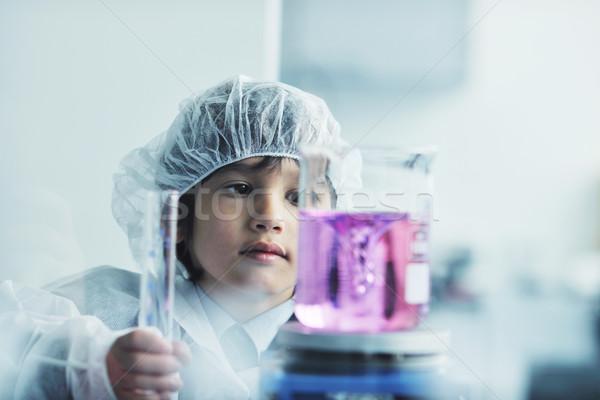 little child scientist in lab Stock photo © dotshock