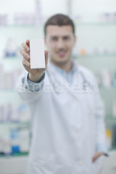 pharmacist chemist man in pharmacy drugstore Stock photo © dotshock