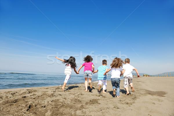 Stockfoto: Gelukkig · kind · groep · spelen · strand · leuk