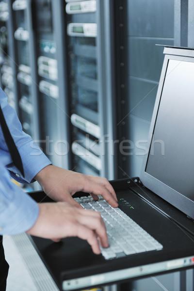 Stock photo: young it engeneer in datacenter server room