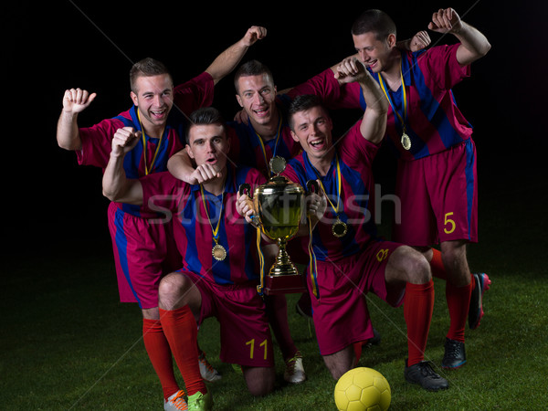 Stock photo: soccer players celebrating victory