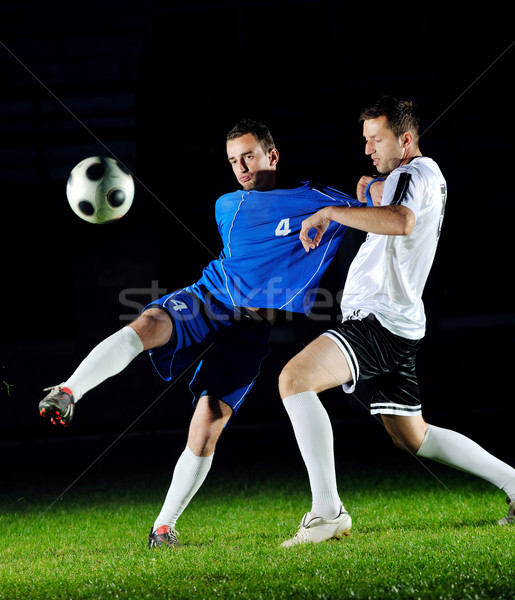football players in action for the ball Stock photo © dotshock
