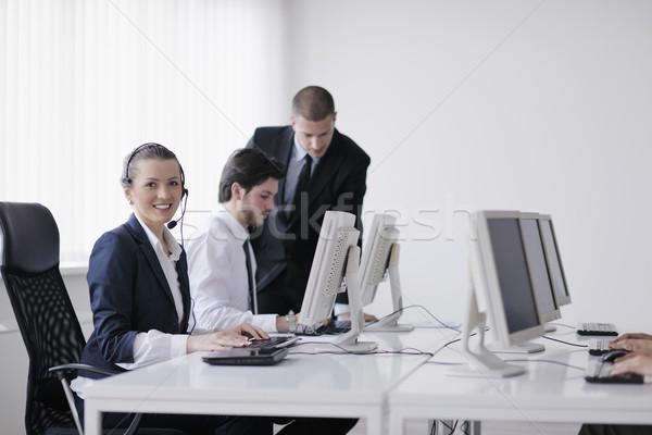 Pessoas de negócios grupo trabalhando cliente ajudar secretária Foto stock © dotshock