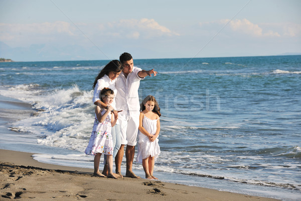 happy young  family have fun on beach Stock photo © dotshock