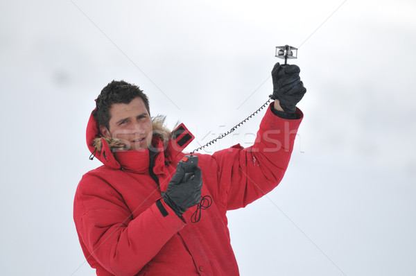 weather meteo man measure wind speed Stock photo © dotshock