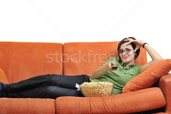 young woman eat popcorn and watching tv Stock photo © dotshock