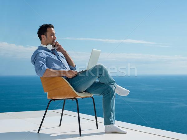 Genç ev balkon yakışıklı rahatlatıcı Stok fotoğraf © dotshock