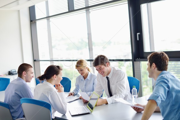 Stock photo: business people in a meeting at office