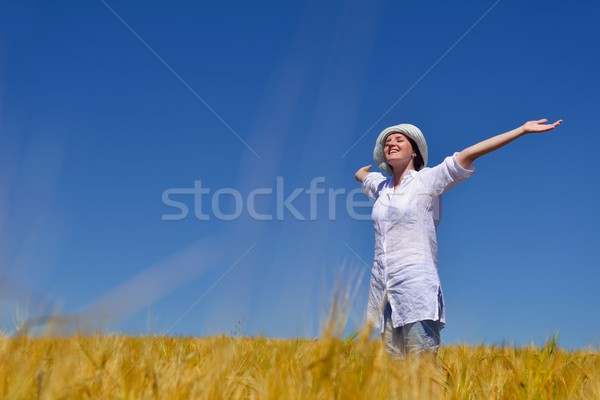 young woman with spreading arms to sky Stock photo © dotshock