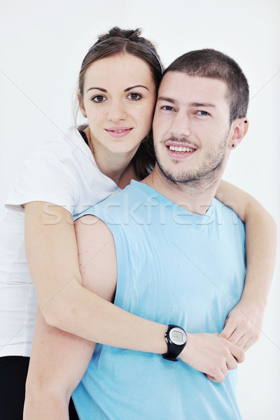 happy young couple fitness workout and fun Stock photo © dotshock
