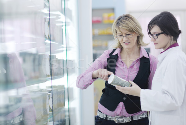 pharmacist suggesting medical drug to buyer in pharmacy drugstore Stock photo © dotshock