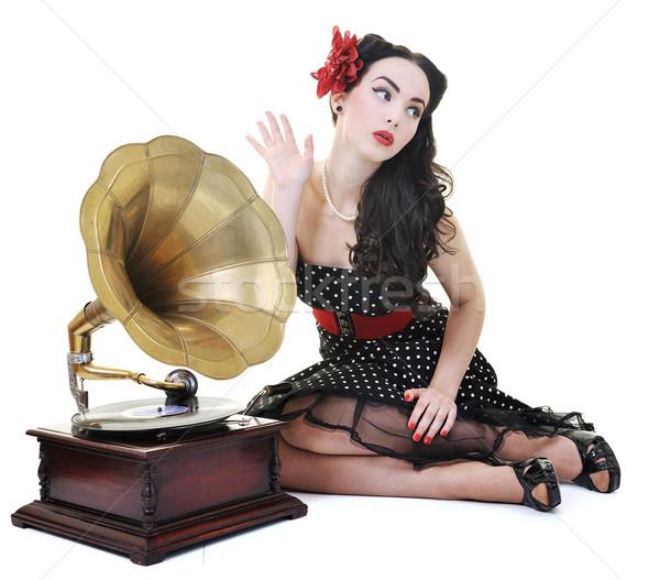 Bastante nina escuchar música edad gramófono Foto stock © dotshock