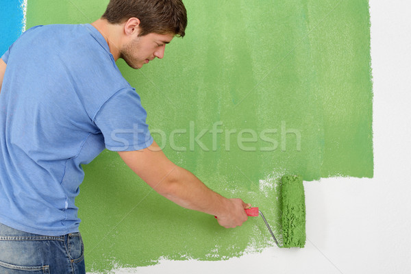 Foto stock: Guapo · joven · pintura · blanco · pared · color