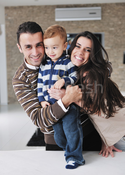 happy young family have fun  at home Stock photo © dotshock